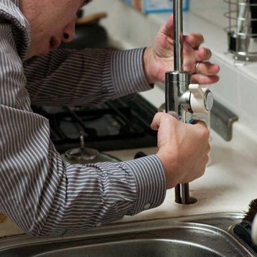 plumber in randburg fixing a tap